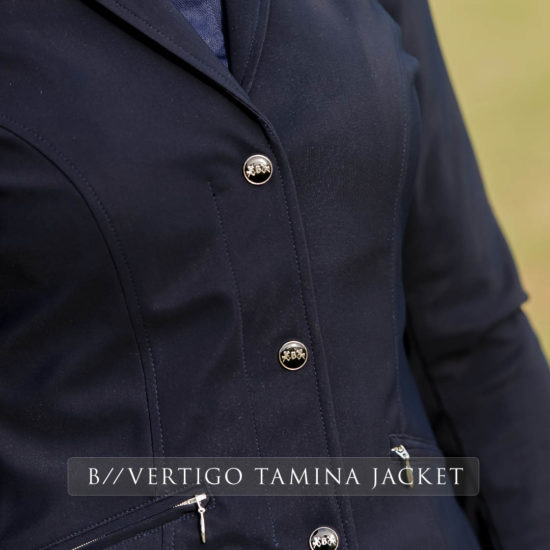 Elegant high class designed show jacket in the B Vertigo range is breathable, dirt repellant and with slanted zipper pockets and a zip beneath the buttons for a perfect fit to compliment any lady